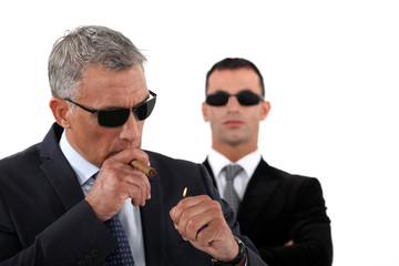 Wealthy businessman smoking cigar