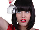 foxy brunette with helmet haircut and red lips inspecting glass
