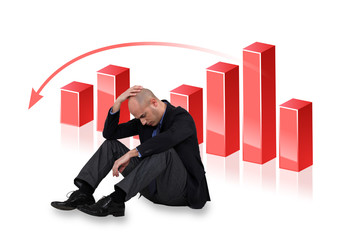Depressed businessman with a downward chart