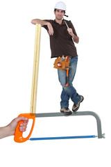 Builder standing on a saw