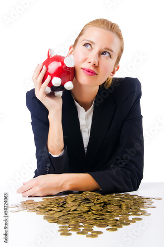 Woman breaking piggy bank for savings