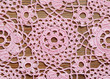 Crochet lace on a wooden surface