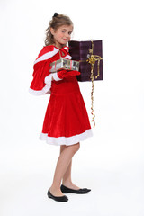 Girl in Christmas costume isolated on white background
