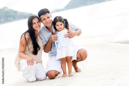 Family smiling at the beach