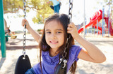Girl On Swing In Park