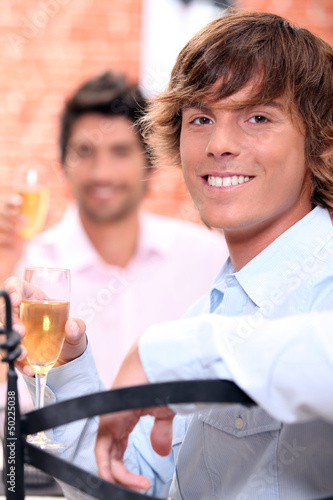 Men drinking champagne