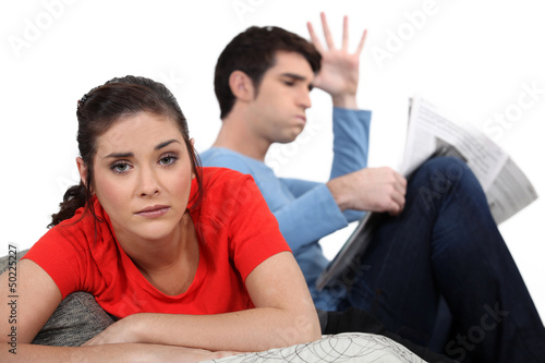 Couple having argument on sofa