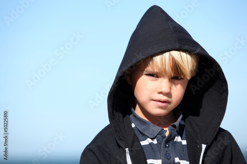 Little boy against a blue sky