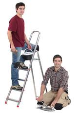 duo of tilers working hand in hand