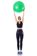 Young girl with swiss ball doing exercise