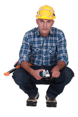 Builder with angle grinder