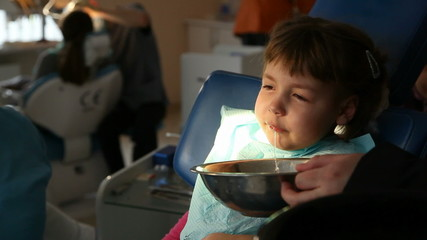 dentist treats teeth child