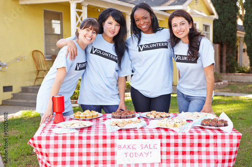 Team Of Women Running Charity Bake Sale