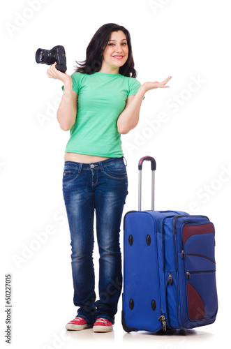 Young girl with travel case and camera
