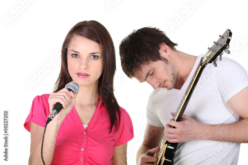 Female singer and male guitarist