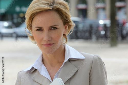 Businesswoman on the sidewalk