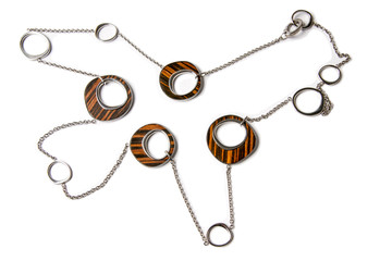 Metal and Wood Necklace Isolated on White.