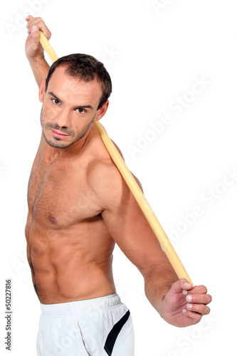 man doing exercises with a stick