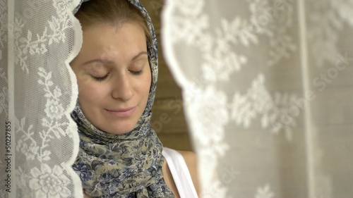 HD1080 Young russian woman with headscarf and book