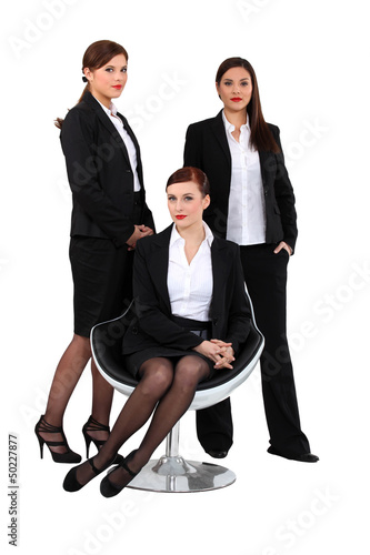 three elegant women in suits