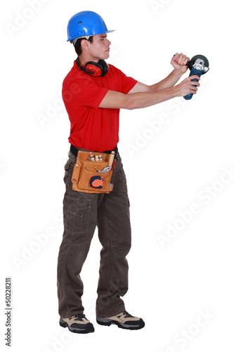 Laborer using angle-grinder