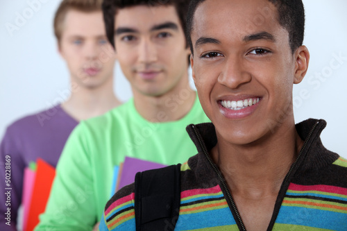 Three male student in line.