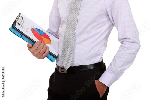 Businessman holding sales report