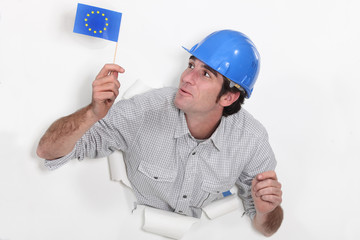 Builder waving a European flag