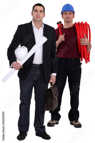 Engineer and tradesman standing side by side