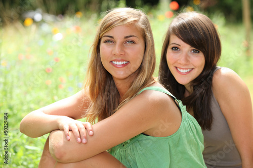 Girls sitting in a field