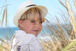 Blond boy surrounded by reeds