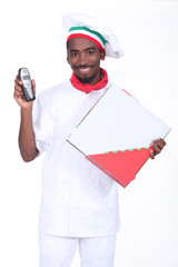 Chef with a telephone and a take away pizza box