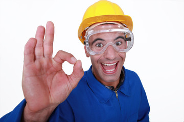 Crazy manual worker giving the go-ahead