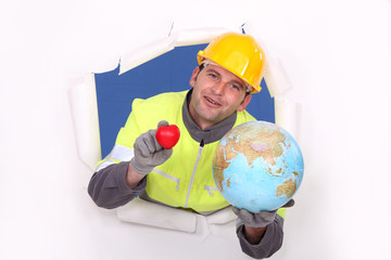 portrait of foreman holding globe