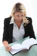 Secretary leafing through an agenda