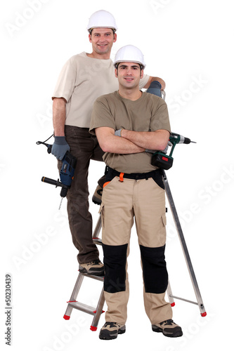 Two electricians stood with ladder