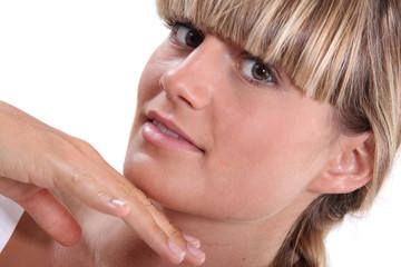 man touching blond woman's chin
