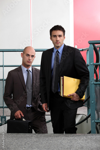 Business associates arriving at work