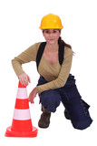 Woman with a traffic cone