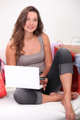 Brunette with computers and bags