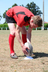 rugby player laying ball