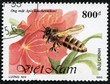 stamp printed in Vietnam shows bee and flower