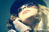 Fashion portrait of a beautiful young woman wearing sunglasses