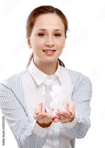 A young woman holding paper people