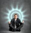 Businessman meditating, relaxing