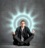 Businessman meditating, relaxing
