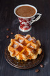 Waffles with honey and a cup of espresso