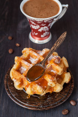 Waffles with honey and a cup of coffee