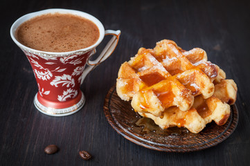 Sweet waffles with honey and coffee