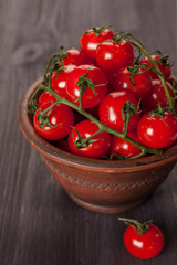 Cherry tomatoes in rustic bowl